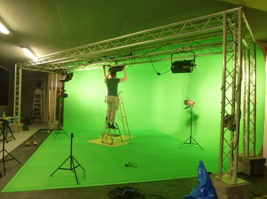Engineers setting up green screen